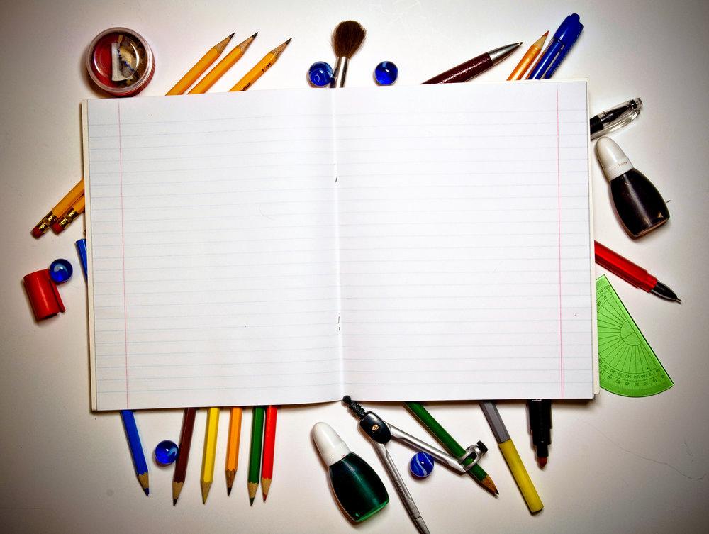 bigstock-Open-writing-book-and-school-t-27243512.jpg