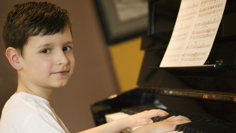 "Traditional learning programs helped my son, who has ADHD and other special needs, concentrate and focus — but nothing helped him as much as music. Whether he was learning an instrument, listening to a classical concerto, or just clapping along to a beat, Brandon found himself and his strengths in the power of sound. BY SHARLENE HABERMEYER Children do not come in tidy packages — they come with spontaneity, energy, and delicious individuality. Some have learning challenges that affect them physically, cognitively, emotionally, and/or behaviorally. The good news is that music can help with most of them. In 1982, my third son, Brandon, suffered a traumatic birth that left him with pre-frontal cortex damage. He was a fussy baby, cried all the time, and had constant ear infections, speech and language delays, and severe separation anxiety. At six, he was diagnosed with ADHD, auditory processing, auditory discrimination, visual-motor, visual perception, and sensory motor problems. The difference between his oral and written IQ was 38 points, indicating severe learning disabilities. A team of school and professional experts concluded that he would have a hard time learning, focusing, and concentrating. They said he may not graduate from high school; college was out of the question. I decided to take the experts' conclusions as one possibility, and not get too discouraged. I researched ADHD and learning disabilities — asking questions and aggressively networking. I learned that it takes time to solve such challenges. I learned that all learning disabilities start with auditory processing — the child can hear, but has difficulty processing what he hears. This can affect his ability to concentrate and focus. I enrolled Brandon in learning programs, many of which helped. But music — and particularly musical instruments — were the real keys to unlocking his ability to learn. Rhythm of Change Music strengthens the areas of the brain that, in the child with ADHD, are weak. Music builds and strengthens the auditory, visual/spatial, and motor cortices of the brain. These areas are tied to speech and language, reading, reading comprehension, math, problem solving, brain organization, focusing, concentration, and attention issues. Studies indicate that when children with ADHD or learning disabilities learn a musical instrument, attention, concentration, impulse control, social functioning, self-esteem, self-expression, motivation, and memory improve. Some studies show that children who have difficulty focusing when there is background noise are particularly helped by music lessons. Starting from birth, Brandon listened to classical music and, by age three, he was taking group music lessons. By five, I was teaching him piano by color-coding the keyboard. By eight, he was taking private lessons. To support Brandon in school, I created musical games. For instance, I made up musical jingles to teach him spelling. We clapped out rhythms while learning addition, subtraction, and multiplication facts. I created songs, jingles, and rhyming couplets for material he was learning in social studies, science, and language arts. Coupled with formal music lessons, concepts became easier for him to grasp and understand. His ability to concentrate and focus for longer periods increased each year. After a long, hard climb, Brandon was accepted to a four-year university, and he eventually graduated with straight A's in film and philosophy. Here are the sound strategies I used with Brandon. I have no doubt that they will work with your child as well. > Start group music lessons. When he is about 18 months old, find a group music program for your child. > Get into the rhythm. Our biological systems work on precise rhythms (think heartbeat). If these rhythms are out of sync, it is hard for anyone to focus and stay on task. Using rhythm instruments is a powerful way to sync the natural biorhythms of the body, allowing the child to feel ""in tune"" with his environment. So put on music with a strong beat — the ""Baby Dance"" CD is good — and beat out, bang out, or clang out the rhythm of the music with your child. > Dance to the music. Movement for a child with ADHD is a must! In fact, movement is an indispensable part of learning, thinking, and focusing. As a child moves to different cadences and rhythms, his physical coordination and ability to concentrate improve. > Draw what you hear. Many children with ADHD are creative and in search of creative outlets. Drawing or doodling engages motor skills, organizes the brain, and stimulates artistic juices. After a busy day at school, and before your child jumps into homework, give her paper and crayons, put on some classical music, and let her draw. I used to play a game with Brandon called ""Draw What You Hear."" I put on classical music and Brandon drew or doodled to the music. Later, when he was in high school, these exercises helped him shut out outside noise, and relaxed his mind. > Read music books. I'm a strong advocate of reading to your children every day. Reading builds focus, concentration, vocabulary, speech and language, and writing skills. I read many books to our sons, some of which were associated with music: Swine Lake, by James Marshall (a great book to introduce your kids to the ballet Swan Lake), and Lentil by Robert McCloskey. > Start private music lessons between the ages of five and seven. If you are a parent with ADHD, take music lessons along with your child. > Find an ADHD-friendly instrument. The string bass, woodwinds, and percussion instruments are good choices, because a child can stand and move while playing them. Let your child choose his own instrument. If he decides on drums, buy earplugs! > March in the morning. Children with ADHD usually have a hard time attending to tasks during the busy morning hours. Every morning, play marching music (John Philip Sousa tunes are great) and march from activity to activity — getting dressed, making beds, eating breakfast, brushing teeth — with feet moving and arms swaying. > Sing your way to school. Teachers want students to be ready to learn when they come to class. So, on your way to school, sing in the car or play classical music. Singing demands total focus. ""The Alphabet Operetta,"" by Mindy Manley Little, is perfect. > Orchestrate homework. Some classical music changes the way the brain processes information by changing its electromagnetic frequencies. As a result of listening, children and adults are able to absorb, retain, and retrieve information better. When doing homework, try listening to George Frederic Handel's Water Music or Johann Sebastian Bach's Brandenburg Concerti. > Combine music and nature. Studies show that listening to music while walking in nature has a beneficial effect on the brain. The combination re-sets the brain — increasing its focus and priming it for learning. How is Brandon doing today? He is married, works in the film industry, and writes blogs on philosophy. Music is still an important part of his life. He listens to classical music while traveling to work each day and plays the piano weekly. Brandon has the tools and understanding to make ADHD his ""friend."" He will always be somewhat of a round peg expected to fit in a square hole, but he is a happy, successful adult who embraces the differences in people. Article taken from:  ADDitude: Strategies and Support for ADHD and LD / ADDitudemag.com"