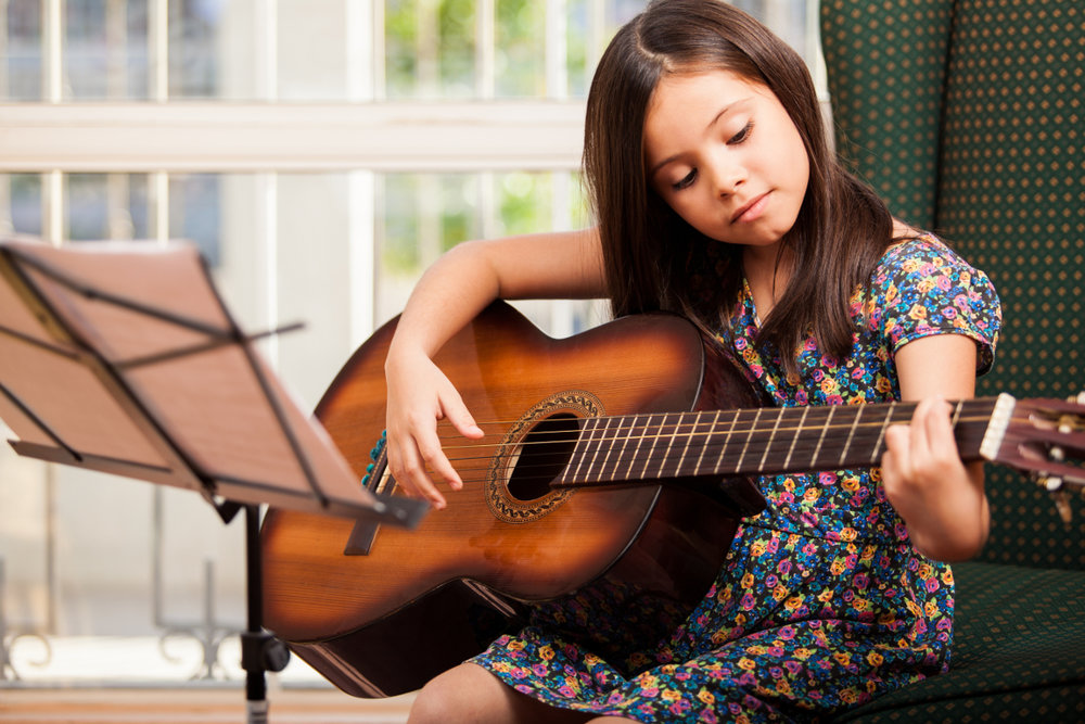 child-learning-guitar-chords.jpg