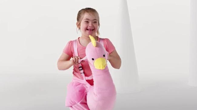Stills from Kmart ad featuring Down syndrome model.