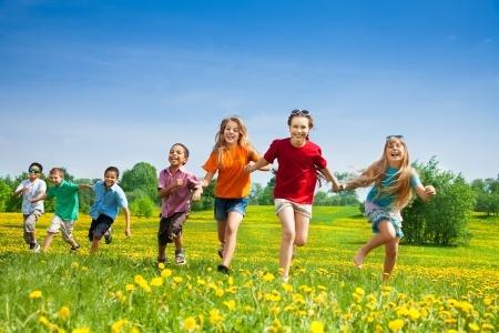 20981372_S_boys_girls_running_playing_grass_summertime_feet_legs.jpg