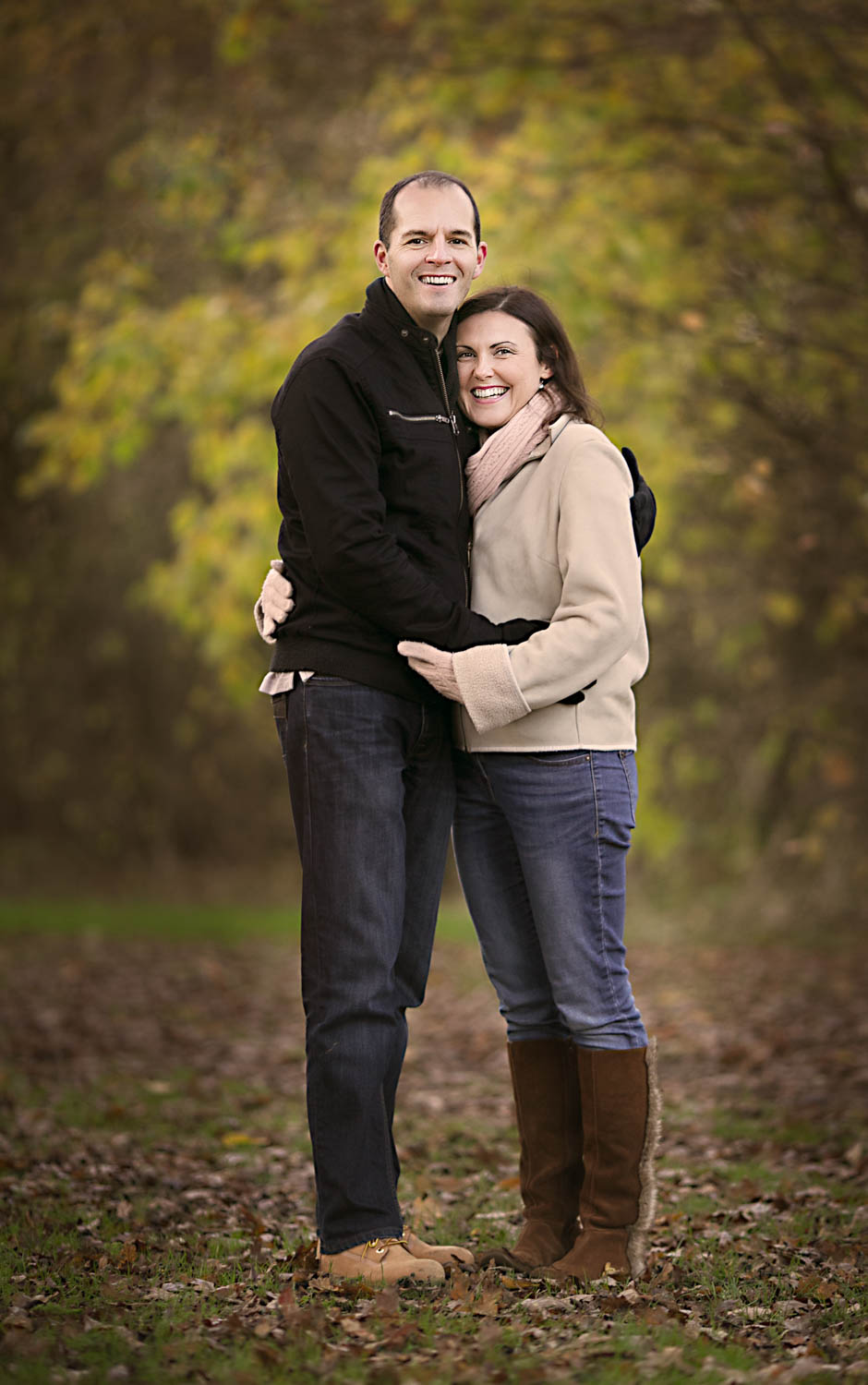 Couple posing during an Autumn family photoshoot in Milton Keynes.