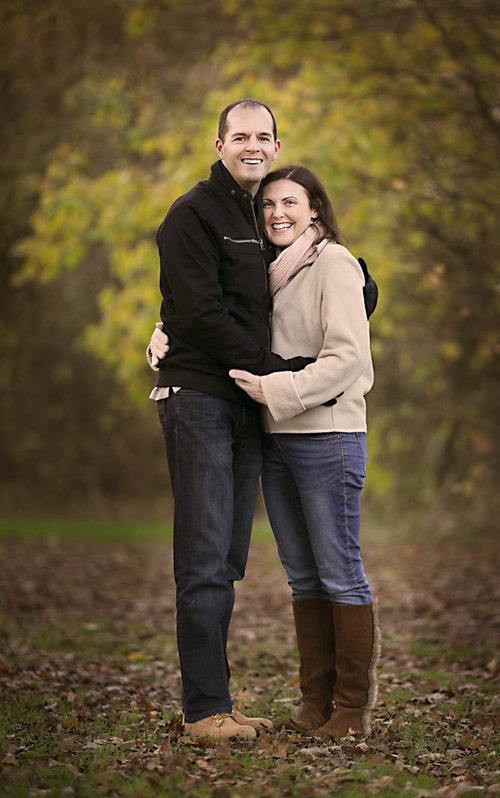 Couple posing during an autumn family photoshoot in milton keynes