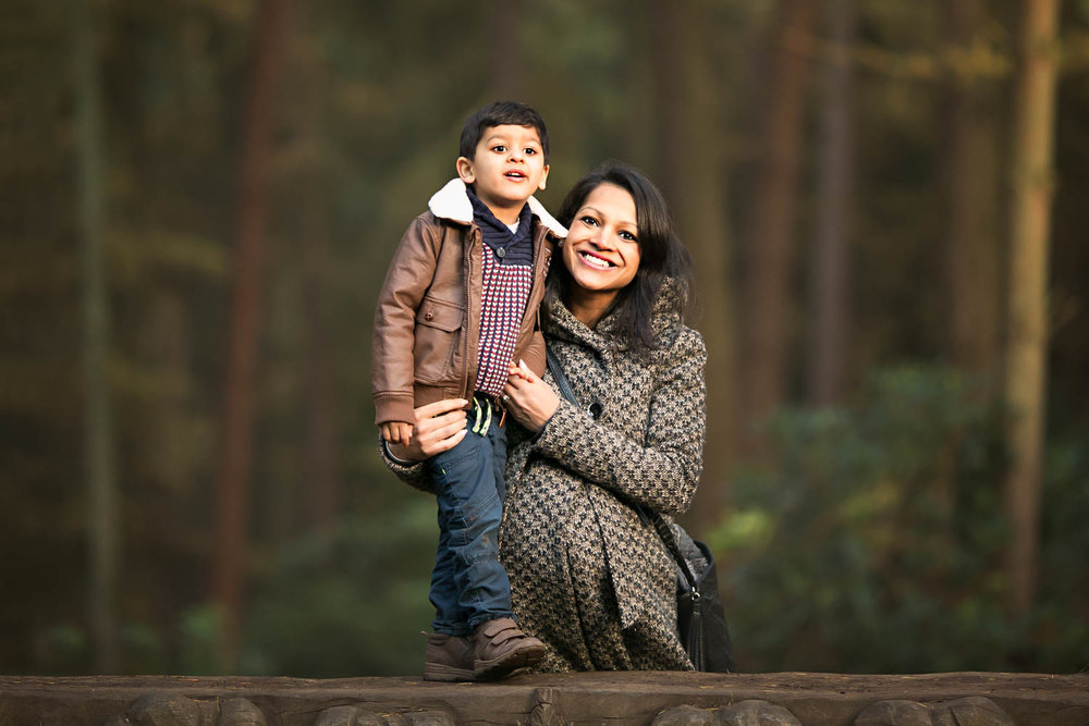Mother and Son pose for a Family portrait during an Autumn family photoshoot at Rushmere Park in Bedfordshire.