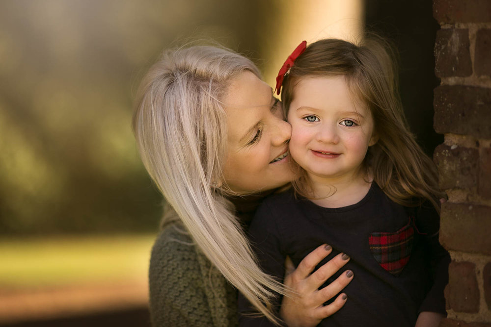 Mother and daughter during autumn family photoshoot at Castle Ashby in Northampton.