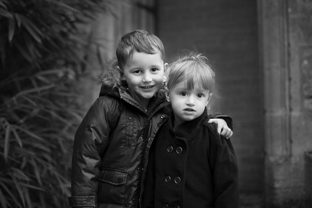 Brother and Sister posing for pre-school photo. Turvey, Bedford.