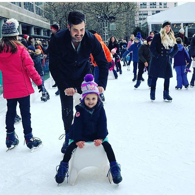 Daddy and Daughter put in some ice time #batterypark. First time? Don't worry, rent one of the ice sleds to make sure you spend more time gliding and less time on your bum on the ice. #icebaby #heyjetsetbaby #iceprincess @bfplny