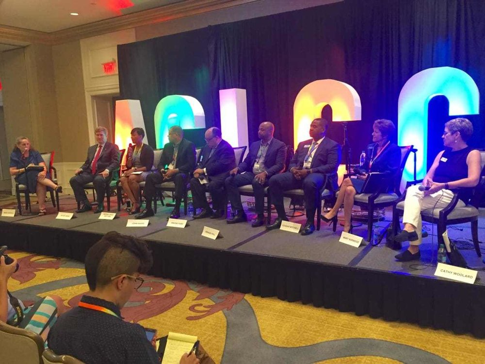 The Atlanta Gay and Lesbian Chamber of Commerce host mayoral forum moderated by Maria Saporta on the far left. The candidates are seated in alphabetical order: Peter Aman, Keisha Lance Bottoms, John Eaves, Vincent Fort, Kwanza Hall, Ceasar Mitchell, Mary Norwood and Cathy Woolard. (Photo courtesy of Amy Wenk)