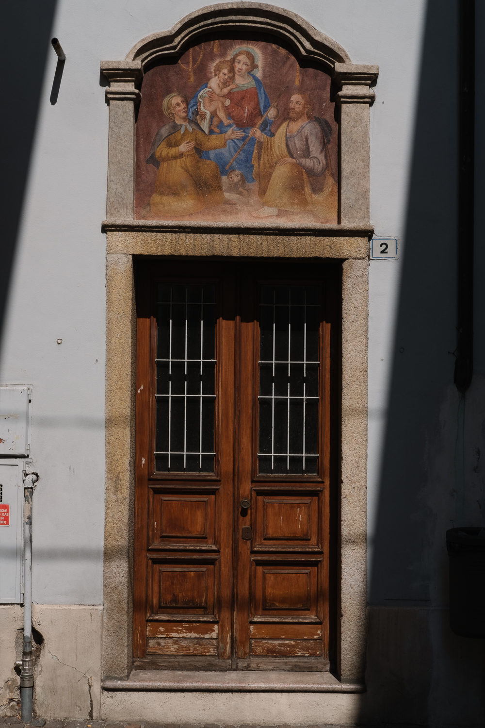 The morning light catching a fresco in Stresa town centre
