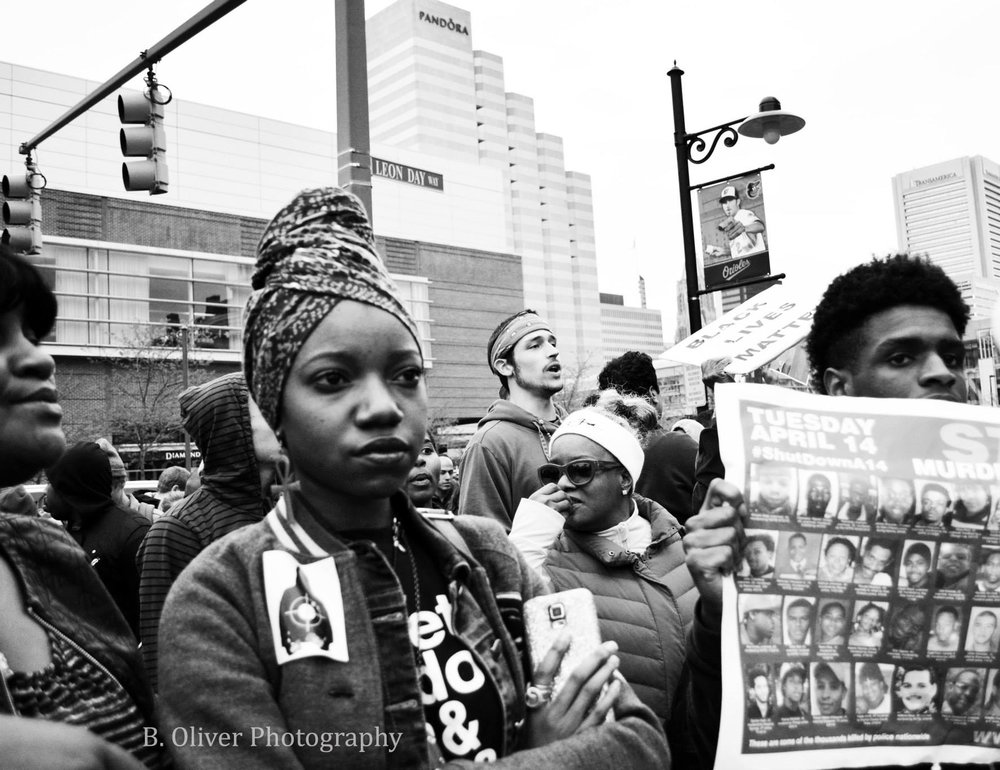 Baltimore Uprising On April 12, 2015, the Baltimore Police arrested Freddie Gray, a 25-year-old African American resident of Baltimore, MD. Gray sustained injuries to his neck and spine while in transport in a police vehicle. On April 18, 2015, after Gray's subsequent coma, residents protested in front of the Western district police station. Gray died the following day, April 19, 2015, which was the birth of the Baltimore Uprising. These are images I captured.