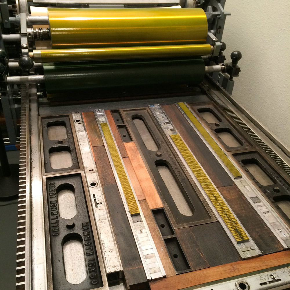 Letterpress type on a printing press