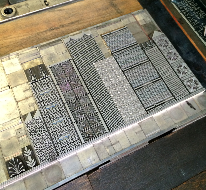 Close up of letterpress metal type of cityscape