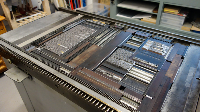 Letterpress metal type on printing press
