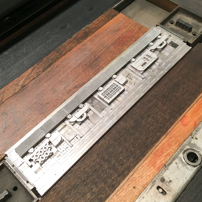Metal type on press to print row of traffic