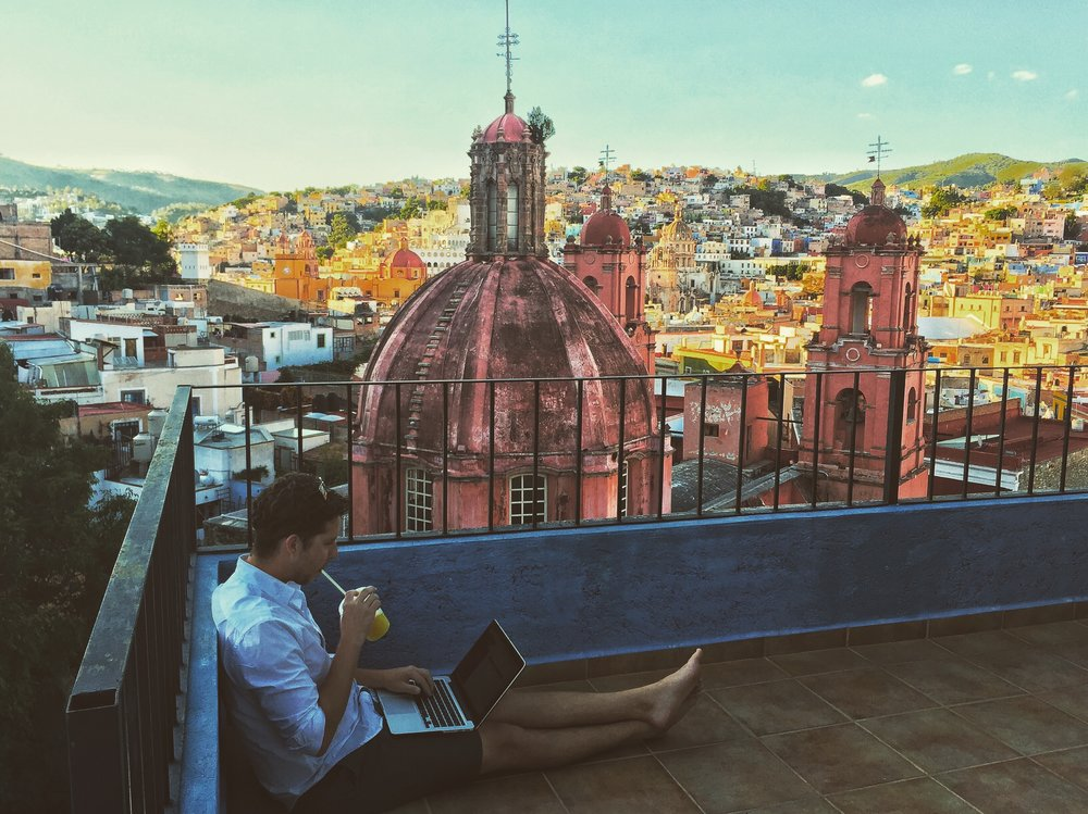 Founder Michael Cummings enjoying a fresh juice on the rooftop in Guanajuato, Mexico