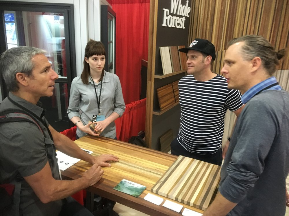 From left to right: Booth visitor Tim Keating; Maura Costello, Design Director; Bradley Sullivan, CEO of  Cider Press WoodWorks and Whole Forest business partner; Garrett Siegers, GM of Ecuadorian Operations