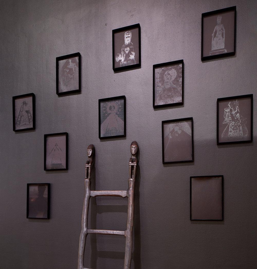 - Installation view: Black Madonnas and Ifugao bulul (rice god) ladderPhoto © Phil Bond