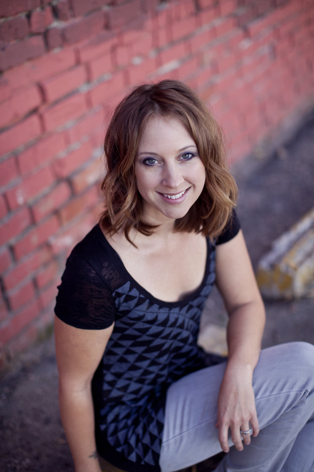 Shannon Briese, Owner of Total Body Wellness, LMT, Pilates Instructor.  Click to Learn More .