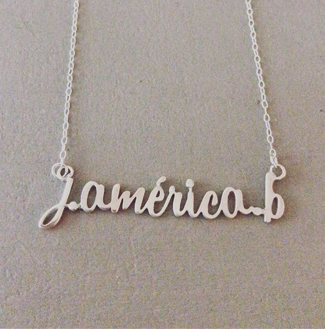 "I shipped this custom ""What's Your Name?"" necklace today to my childhood friend Jen @lajennie_americabeltran (full name Jennifer América Beltrán). She is a daughter of Salvadoran immigrants. 🇸🇻 She is also one of my best customers and supporters of my small business. Regarding the recent horrific family separations happening at the border, Jen and her sisters said ""That could be me, that could be us"". ❤️ I like designing these name necklaces because of the surprised response I get especially from my women of color customers. They say, ""This is awesome! I'm definitely ordering this necklace because I can NEVER find anything with my name on it"". ❤️ Latina women have quickly become almost half of my customer base. Not only do my Latina friends (often immigrants or children of immigrants) make my personal life more vibrant and interesting, but my Latina customers are great shoppers who are enthusiastic, loyal and do a wonderful job of ""spreading the word"" about my local jewelry line. (*often in Spanish!) 🙌🏽🙌🏾🙌🏿 These immigrants make my business better, stronger and frankly, way more profitable.💰💵 I think we all agree that family separation is horrific no matter the circumstance which is why I'll be donating 10% of my proceeds for the rest of the month to RAICES. @raicestexas 👪👩‍👩‍👧👨‍👨‍👧 I'd like to propose we change the conversation: How do immigrants help your business or personal life? And how do you help them? Please leave your comments below! ⬇️⬇️ Just like Jen's middle name, this is América. 🇺🇸 Let's get to work. 💪🏼💪🏽💪🏾💪🏿"