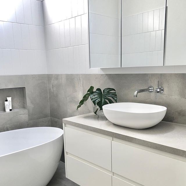 Subtle contrasting tile patterns in this bathroom ✔️ . . . #bathroom #bathroomdesign #bathroomrenovation #interiordesign #interiors #style #grey #white #tilepatterns #vanity #basin #bath #melbourneinteriordesign #melbourneinteriordesigner #plants @faucetstrommen #quantumquartz #faucetstrommen #salusbody
