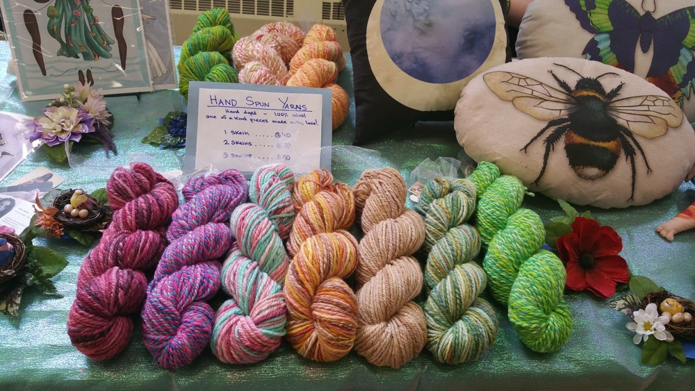 A photo of my hand spun and hand dyed yarns for sale at one of our past events.