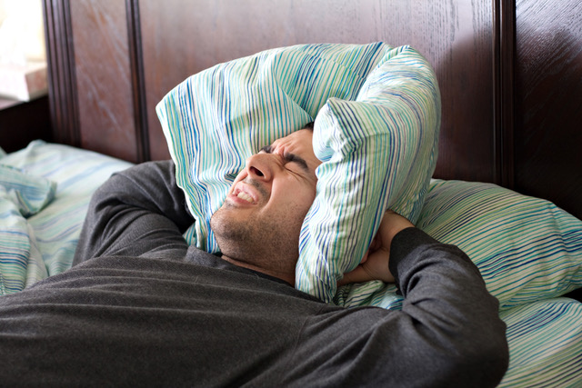 Man Having Trouble Sleeping