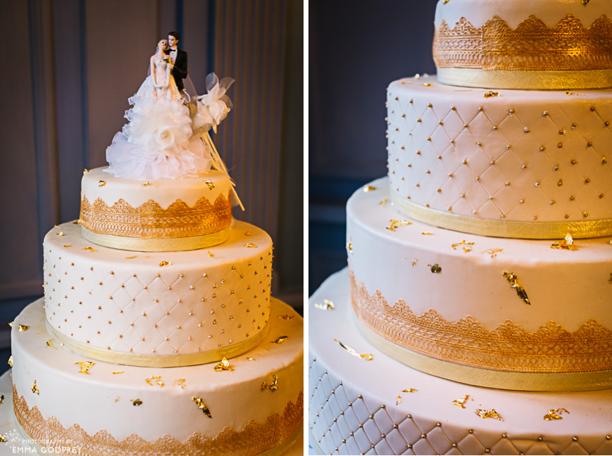 Four-tiered wedding cake in white and gold