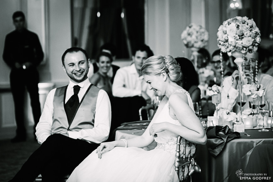 Bride laughs at wedding slideshow