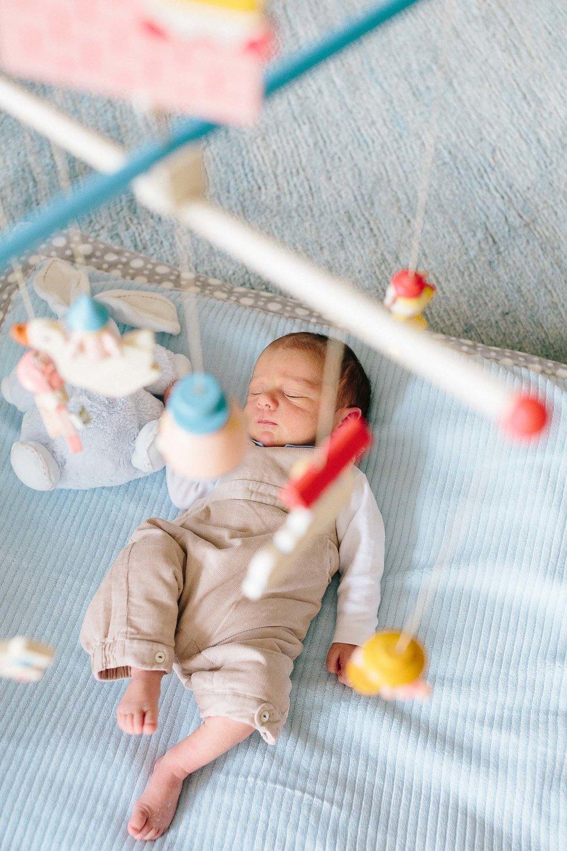 Newborn portrait with mobile baby boy photo.jpg