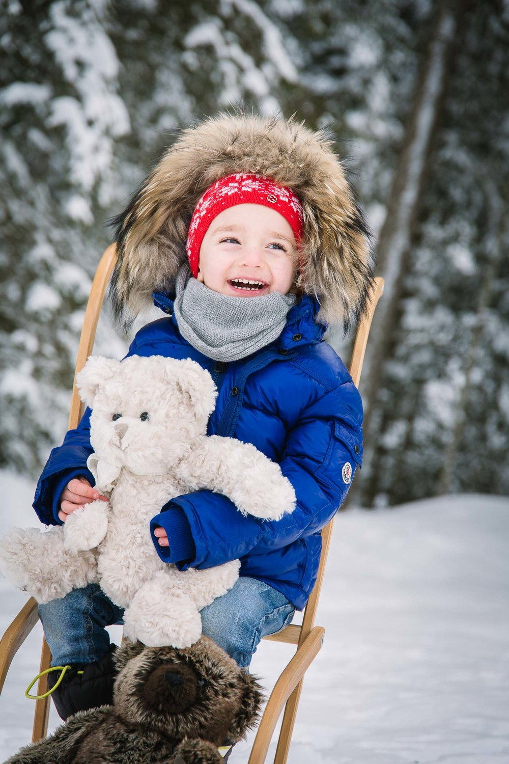 Props and toys make for a fun family shoot in the snow.