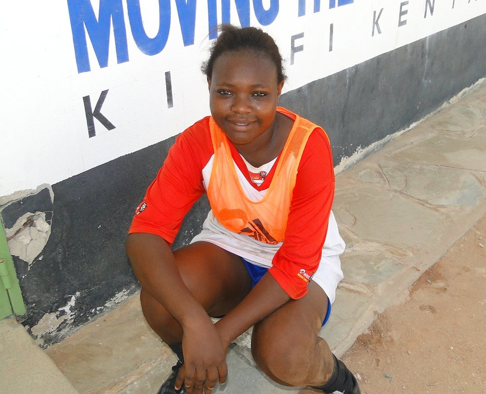 AMINA FONDO  Age: 20 Potition: Midfielder  My dream is to be the winner of The Global Goals tournament. I would like to go the UN general Assembly and meet the world leaders, tell them of my story of how playing Sport has changed my life. I would like to tell them to promote Sport for girls and young Women in all parts of the World.