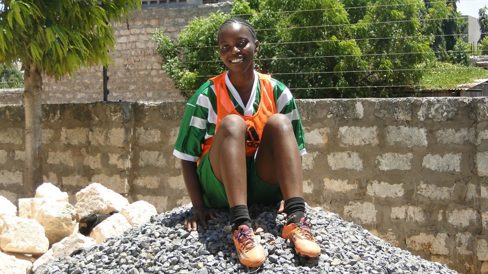 Sarah Rehema Kitsao  Age: 24 Position: Goalkeeper Winning and Losing are among the many great lessons we learn in football. I have grown through MTG. I had my daughter when I was 20 years. My daughter is now 5 years she loves playing football. Every Sunday during practice she comes to the field wears her training kit and sits on the touchline to cheer me on.