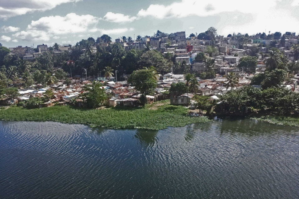 The neighborhood of La Barquita floods three or four times a year, and flooding is expected to increase because of climate change. (image from article by Renee Lewis)