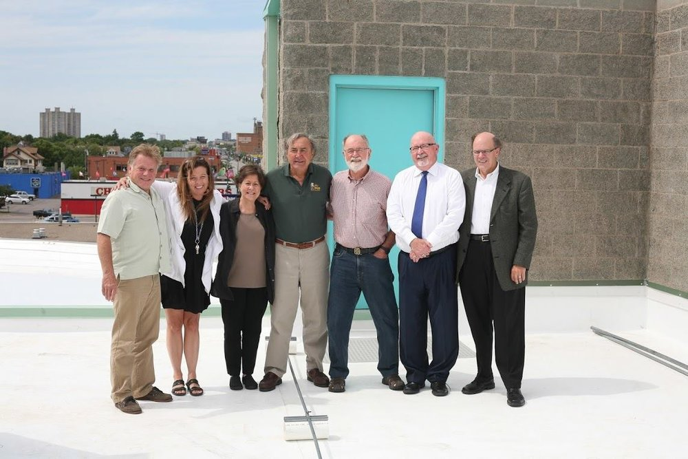 Division of Indian Work's Executive Director, Louise Matson (second to the left), poses with our Board of Directors on our brand new roof!