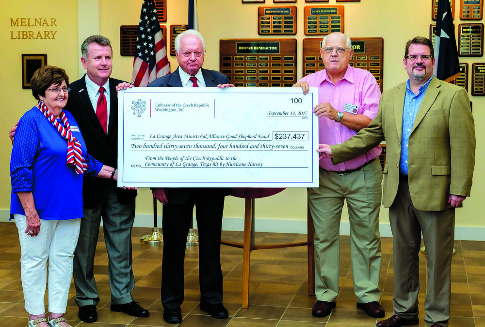 Czech Republic Helps Czech-Texan Community Hit by Harvey  Brian Vanicek, Honorary Consul General to the Czech Republic for the State of Texas (second from left) presented a check for $237,437 from the Czech Republic to help La Grange citizens recover from flooding caused by Hurricane Harvey. Accepting the very generous donation at TCHCC on Fri., Sept. 15 were (l-r)   Retta Chandler, TCHCC President; Ed Janecka, Fayette Co. Judge; John J. Cernosek, Mayor Pro Tem of La Grange; and Jonathon Smith, Adm of Good Shepherd's Fund.