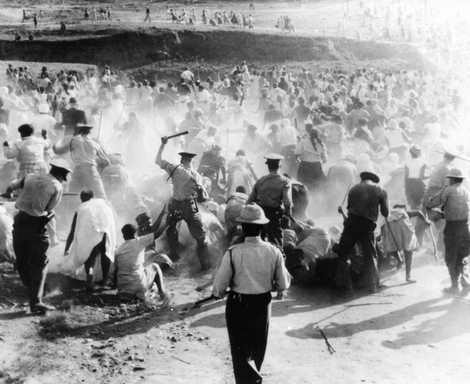 The poem  memorias negras  by Aída Cartagena Portalatín deals with the 1960 Sharpeville massacre in South Africa.  Source : from ANC archives, unknown photographer via Apartheid South Africa.
