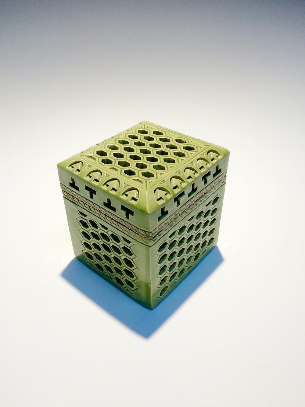 "Ceramic box with Celadon glaze, cone 5. 4.5""x5""x5"". Sculpted by Camille Ochoa"