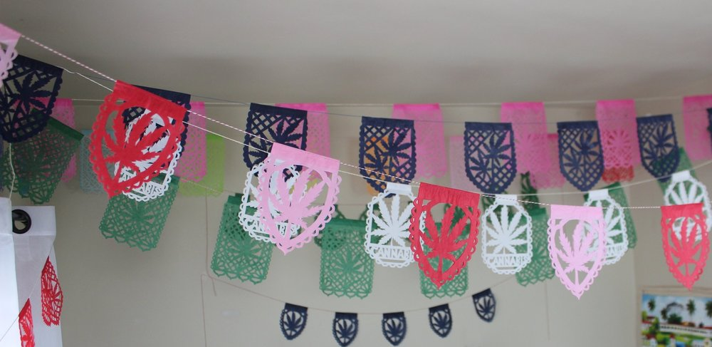 Many different colors of papel picado are stung up in my office from the new line by Canna Reign Studios.