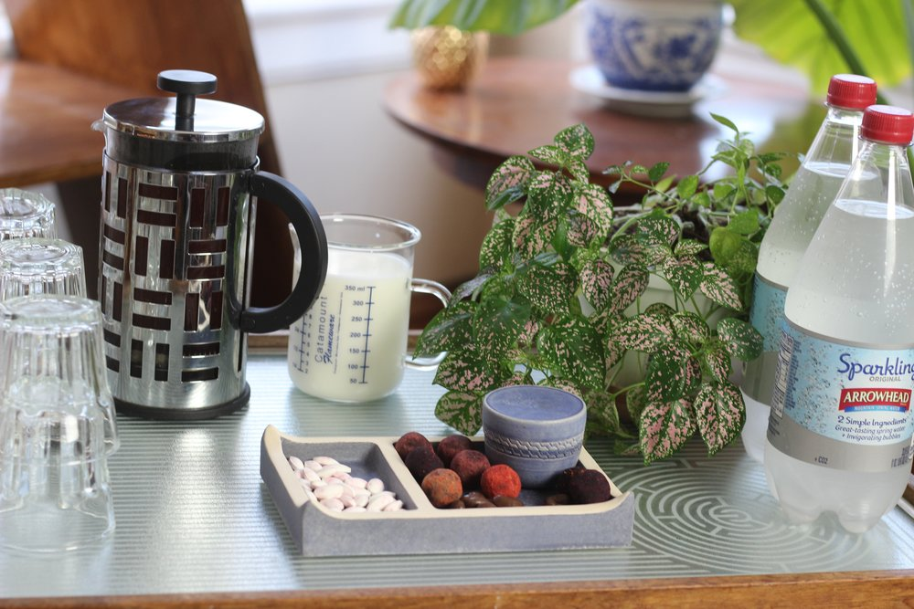 Cannabis edibles tray by  Canna Reign with french press coffee