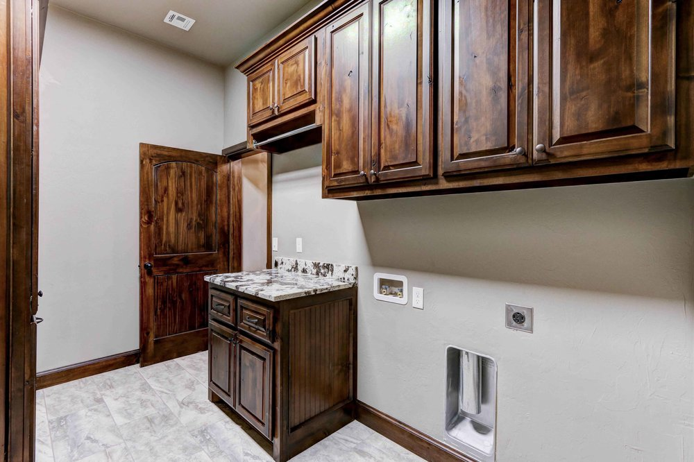 Stained Cabinets Laundry Room
