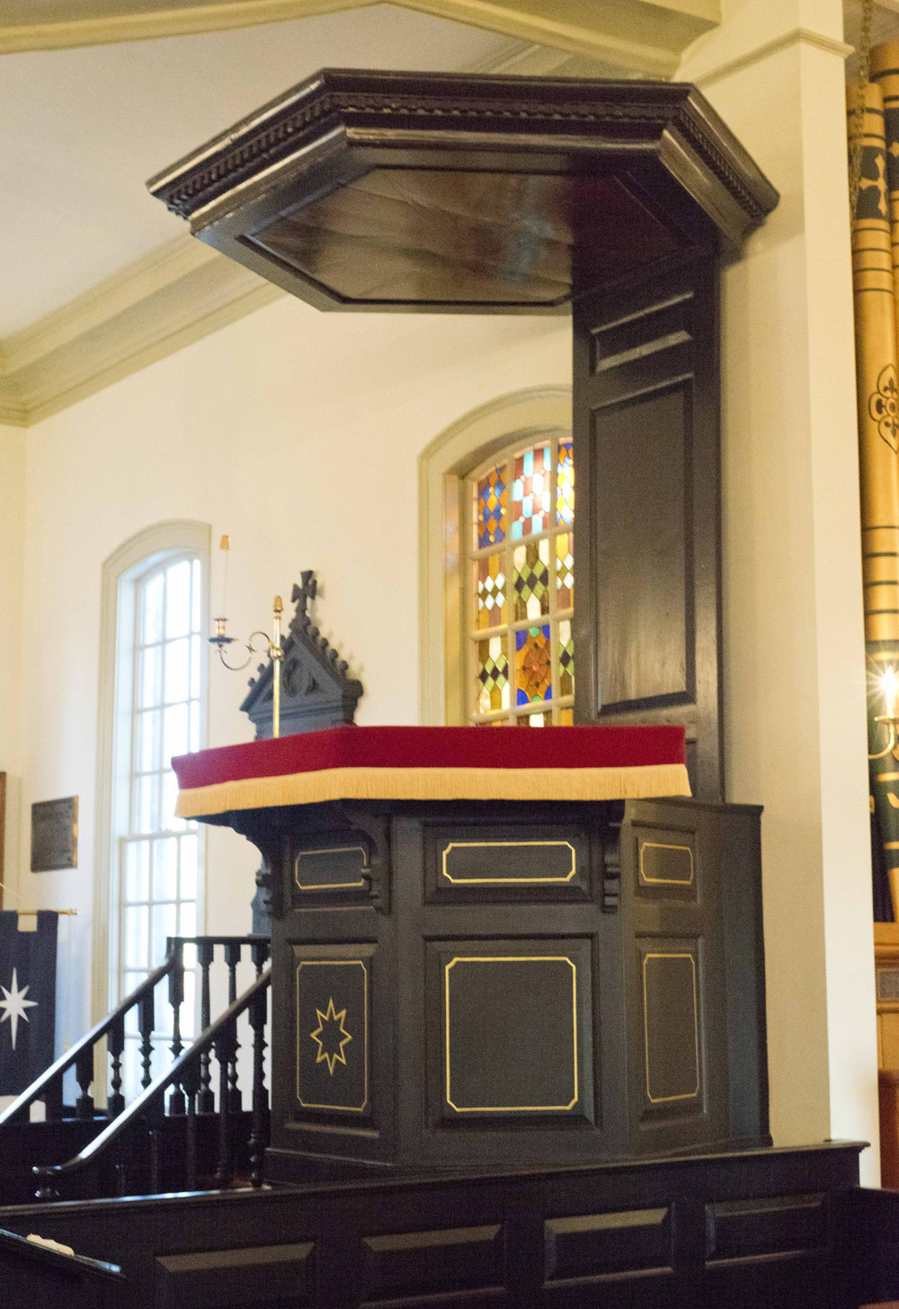 The sounding board which dates to 1741 is located above the pulpit inside St. John's.