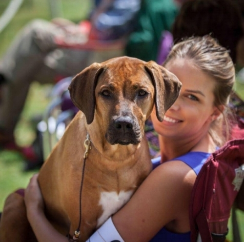 (A photo of me in my realest form, nerding out at a dog show with my heart dog. I'm incredibly happy in this photo.)