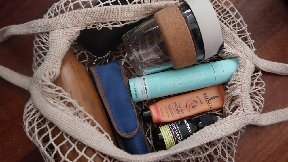 My handbag contains my water bottle, KeepCup, reusable cutlery kit, sunglasses (in a nondescript case to draw attention away from my designer glasses), face mist spray, pawpaw ointment and hand sanitiser.