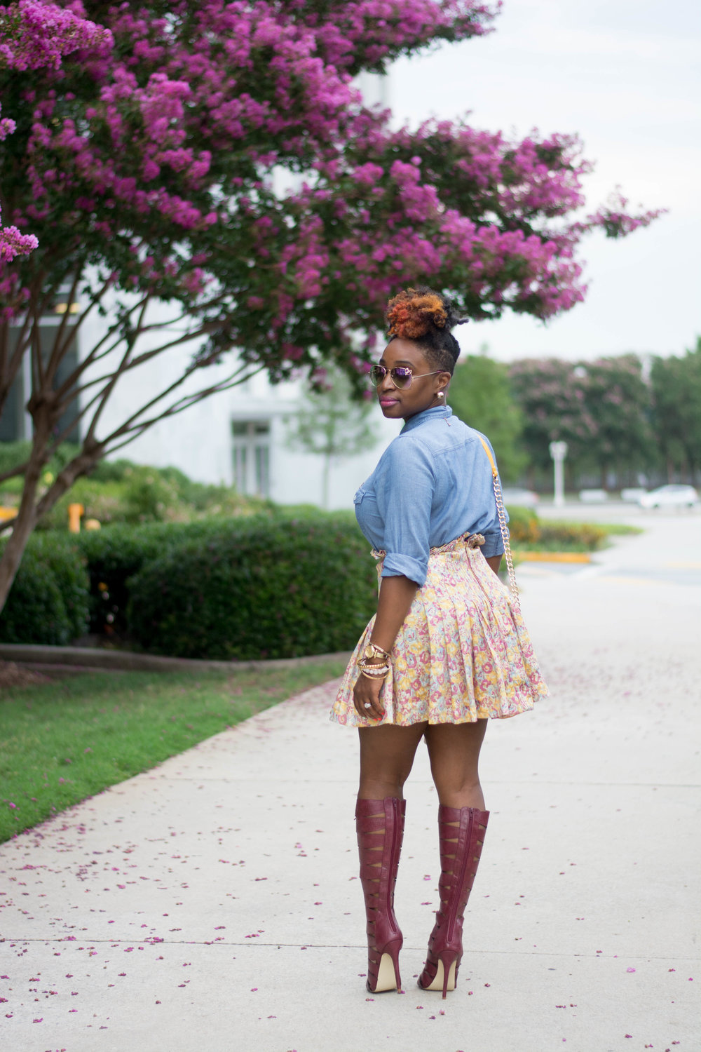 Atlanta stylist wearing a chambray top and floral mini skirt with tall Bordeaux lace up boots