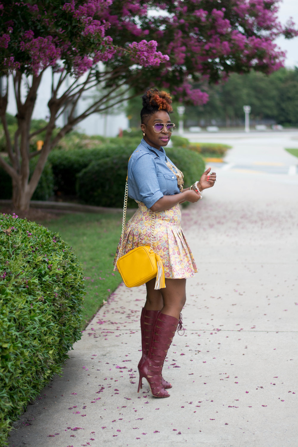 Atlanta style blogger, chambray top and floral mini skirt with tall Bordeaux lace up boots