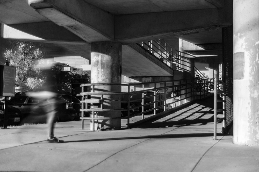 A pedestrian walks onto the bridge in Berwyn. In order to slow down my shutter, a majority of these images were shot with an Infrared filter, hence why they are in black and white.
