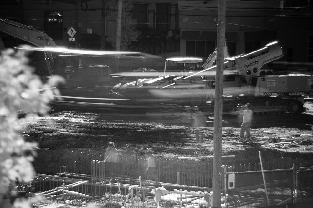 A cement truck moves at a construction site on Route 1. In order to slow down my shutter, a majority of these images were shot with an Infrared filter, hence why they are in black and white.