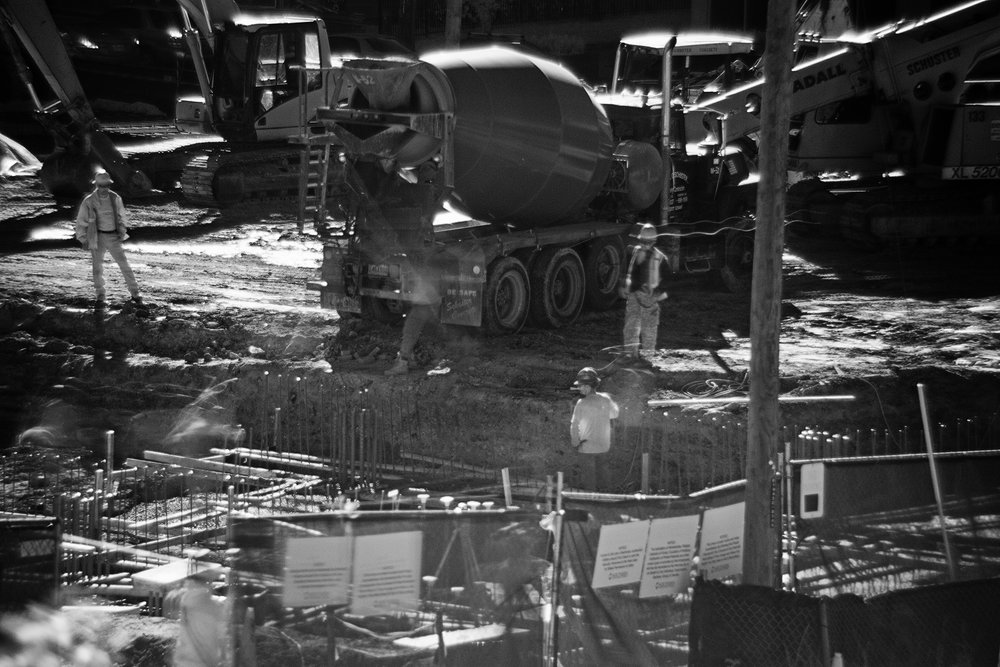 A crew pours cement at a construction site on Route 1. In order to slow down my shutter, a majority of these images were shot with an Infrared filter, hence why they are in black and white.