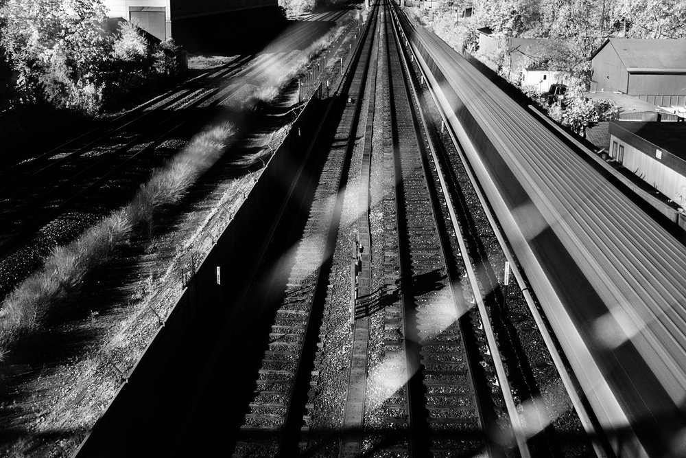 A Green-line metro train travels along the tracks. In order to slow down my shutter, a majority of these images were shot with an Infrared filter, hence why they are in black and white.