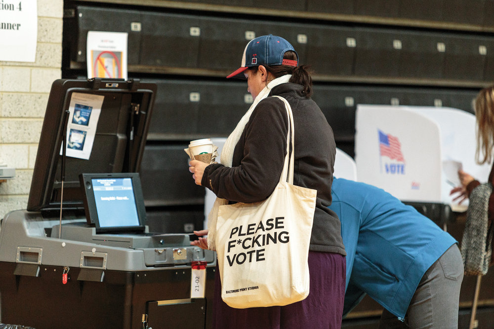 A College Park resident submits her ballot in the Ritchie Colliseum voting location. The 2016 presidential election was volatile at times, and Donald Trump was victorious.